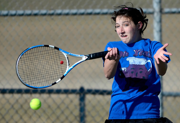Broomfield's Monro Obenauer returns a ball while playing doubles against Fairview during their tennis match at Broomfield Swim and Tennis Club in Broomfield, Colorado March 20, 2012.   CAMERA/MARK LEFFINGWELL