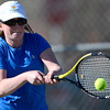 Broomfield's Dayna DeMeritte returns the ball to Fairview's Monica Li during their tennis match at Broomfield Swim and Tennis Club in Broomfield, Colorado March 20, 2012.   CAMERA/MARK LEFFINGWELL