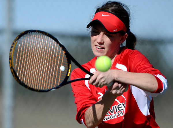 Fairview's Katie Kuosman plays Broomfield's Katie Chrisman during their tennis match at Broomfield Swim and Tennis Club in Broomfield, Colorado March 20, 2012.   CAMERA/MARK LEFFINGWELL