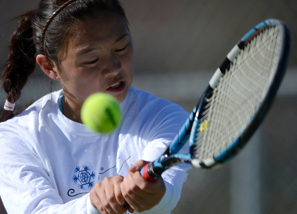 Fairview's Monica Li returns the ball to Broomfield's Dayna DeMeritte during their tennis match at Broomfield Swim and Tennis Club in Broomfield, Colorado March 20, 2012.   CAMERA/MARK LEFFINGWELL
