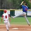 "Jeff Manders (19) of Centaurus tries to get the out on second of Ryan Madden of Fairview.<br /> For  more photos of the game, go to  <a href=""http://www.dailycamera.com"">http://www.dailycamera.com</a>.<br /> Cliff Grassmick  / August 2, 2012"