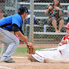"Alez Blazon, left, of Centaurus, tags out Jake Thoning of Fairview at home.<br /> For  more photos of the game, go to  <a href=""http://www.dailycamera.com"">http://www.dailycamera.com</a>.<br /> Cliff Grassmick  / August 2, 2012"