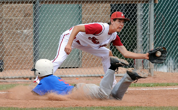 "Ryan Madden of Fairview tries to turn a double play, getting Ryan Norton of Centaurus out at third.<br /> For  more photos of the game, go to  <a href=""http://www.dailycamera.com"">http://www.dailycamera.com</a>.<br /> Cliff Grassmick  / August 2, 2012"