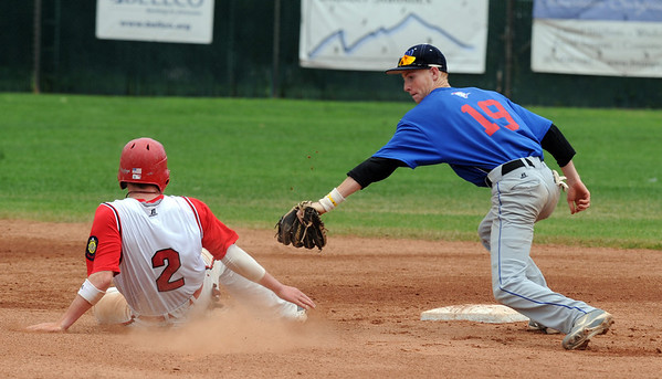 """Jeff Manders (19) of Centaurus tries to get the out on second of Jeremy Katz of Fairview.<br /> For  more photos of the game, go to  <a href=""""http://www.dailycamera.com"""">http://www.dailycamera.com</a>.<br /> Cliff Grassmick  / August 2, 2012"""