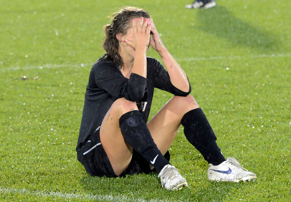 "Fairview High School's Olivia Fear shows her emotions after losing  the Class 5A State Championship against Cherry Creek High School on Wednesday, May 23, at Dick's Sporting Good Park in Commerce City. Fairview lost the game 1-0. For more photos of the game go to  <a href=""http://www.dailycamera.com"">http://www.dailycamera.com</a><br /> Jeremy Papasso/ Camera"