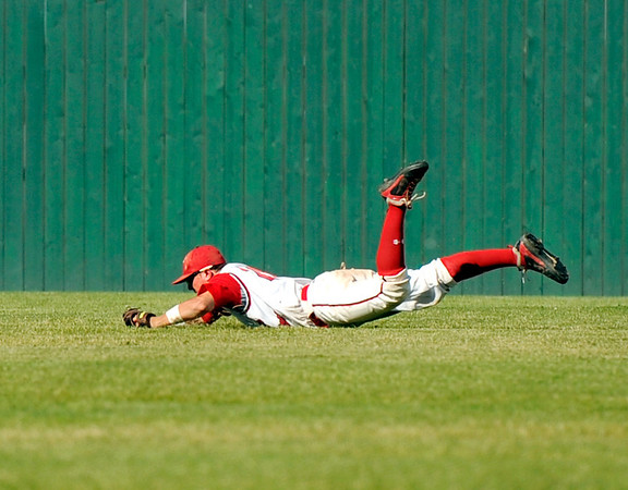 Fairview's Clay Jennette makes a diving catch in right field on Friday, July 8,  during a baseball game against the Colorado Twins at Fairview High School. Fairview won 5-1.<br /> Jeremy Papasso/ Camera