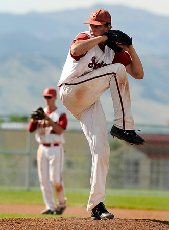 Fairview pitcher Brad Reynolds winds up on Friday, July 8,  while pitching in a baseball game against the Colorado Twins at Fairview High School. Fairview won 5-1.<br /> Jeremy Papasso/ Camera