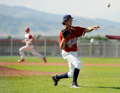 Colorado Twins pitcher Hunter Pickett makes a play at first base on Friday, July 8,  during a baseball game against the Fairview Knights at Fairview High School. Fairview won 5-1. Jeremy Papasso/ Camera