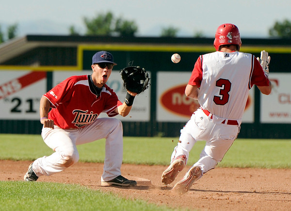 Colorado Twins infielder Marcus Steward tags out Fairview's Cameron Frazier on Friday, July 8,  during a baseball game at Fairview High School. Fairview won 5-1.<br /> Jeremy Papasso/ Camera