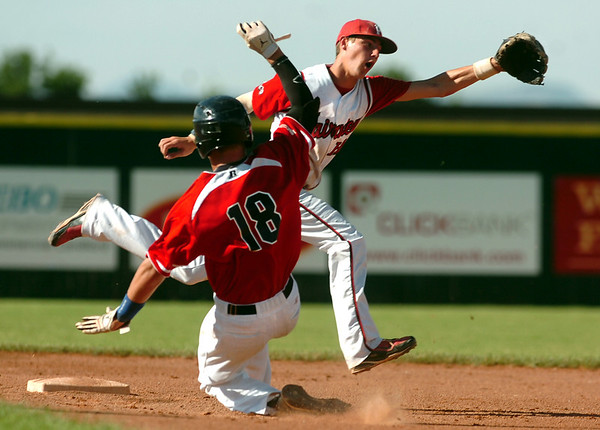 Fairview shortstop Travis Scavo misses the ball as Colorado Twins catcher Jaron Balman slides into second base safely on Friday, July 8,  during a baseball game at Fairview High School. Fairview won 5-1.<br /> Jeremy Papasso/ Camera