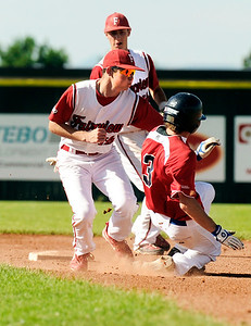 Fairview's Cameron Frazier tags out Joey Cinea at second base on Friday, July 8,  during a baseball game against the Colorado Twins at Fairview High School. Fairview won 5-1. Jeremy Papasso/ Camera