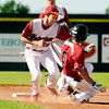 Fairview's Cameron Frazier tags out Joey Cinea at second base on Friday, July 8,  during a baseball game against the Colorado Twins at Fairview High School. Fairview won 5-1.<br /> Jeremy Papasso/ Camera