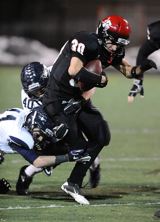 FAIRVIEW<br /> Fairview's Ben Meyer struggles to break the grasp of Trey Quinn of Columbine.<br /> <br /> PHOTO BY MARTY CAIVANO<br /> Nov. 11, 2011