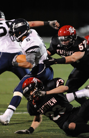 FAIRVIEW<br /> <br /> Fairview's Carsen Will tries to tackle Caesar Lopez of Columbine.<br /> PHOTO BY MARTY CAIVANO<br /> Nov. 11, 2011