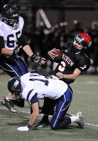 FAIRVIEW<br /> <br /> Fairview quarterback Michael McVenes is sacked by Ryan Earnest of Columbine.<br /> PHOTO BY MARTY CAIVANO<br /> Nov. 11, 2011
