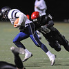 FAIRVIEW<br /> Fairview's Andrew Cobb takes down Columbine quarterback Michael Burns.<br /> PHOTO BY MARTY CAIVANO<br /> Nov. 11, 2011