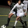 Fairview High School sophomore Kristin Breakell dribbles the ball up the field past Fossil Ridge's Sarah Tani on Friday, April 29, during a soccer game against Fossil Ridge High School at Fairview.<br /> Jeremy Papasso/ Camera