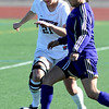 FVSOCCER<br /> Fairview's Berkley Gamble fights for the ball against Brianna Valdez of Ft. Collins.<br /> Photo by Marty Caivano/March 31, 2011