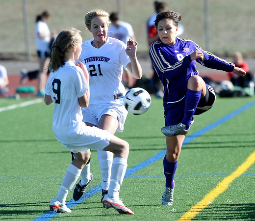 FVSOCCER<br /> Fairview players Kristin Breakell, left, and Berkley Gamble push to get the ball from Brianna Valdez of Ft. Collins.<br /> Photo by Marty Caivano/March 31, 2011