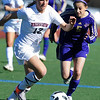 FVSOCCER<br /> Fairview's Daphnee Morency drives to the ball ahead of Alex Laureles of Ft. Collins.<br /> Photo by Marty Caivano/March 31, 2011