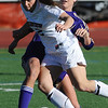 FVSOCCER<br /> Fairview's Daphnee Morency fights for the ball against Megan Speed of Ft. Collins.<br /> Photo by Marty Caivano/March 31, 2011