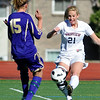 FVSOCCER<br /> Fairview's Berkley Gamble fires the ball past Zoey Weappa of Ft. Collins.<br /> Photo by Marty Caivano/March 31, 2011