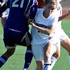 FVSOCCER<br /> Fairview's Daphnee Morency collides with Megan Speed of Ft. Collins while fighting for the ball.<br /> Photo by Marty Caivano/March 31, 2011