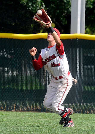 "Fairview's Walker Harris makes a catch in the outfield during a Legion A game against the Gene Taylor's on Friday, Aug. 3, at Scott Carpenter Park in Boulder. For more photos of the game go to  <a href=""http://www.dailycamera.com"">http://www.dailycamera.com</a><br /> Jeremy Papasso/ Camera"