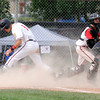 """Fairview's Canon Casey, right, misses the tag on Owen Taylor during a Legion A game against the Gene Taylor's on Friday, Aug. 3, at Scott Carpenter Park in Boulder. For more photos of the game go to  <a href=""""http://www.dailycamera.com"""">http://www.dailycamera.com</a><br /> Jeremy Papasso/ Camera"""