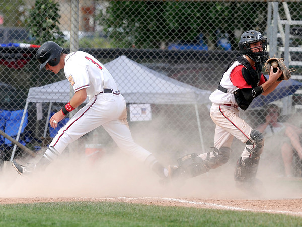 "Fairview's Canon Casey, right, misses the tag on Owen Taylor during a Legion A game against the Gene Taylor's on Friday, Aug. 3, at Scott Carpenter Park in Boulder. For more photos of the game go to  <a href=""http://www.dailycamera.com"">http://www.dailycamera.com</a><br /> Jeremy Papasso/ Camera"