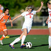"""Fairview High School's Reci Smith moves the ball upfield past Grand Junction's Sam Melchor during a soccer game against Grand Junction High School on Wednesday, May 9, at Fairview in Boulder. For more photos of the game go to  <a href=""""http://www.dailycamera.com"""">http://www.dailycamera.com</a><br /> Jeremy Papasso/ Boulder Daily Camera"""