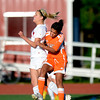 """Fairview High School's Savannah Beetcher heads the ball over Grand Junction's Sam Melchor during a soccer game against Grand Junction High School on Wednesday, May 9, at Fairview in Boulder. For more photos of the game go to  <a href=""""http://www.dailycamera.com"""">http://www.dailycamera.com</a><br /> Jeremy Papasso/ Boulder Daily Camera"""