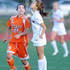 """Fairview High School's Sophie Fear heads the ball over Grand Junction's Jordan Drake during a soccer game against Grand Junction High School on Wednesday, May 9, at Fairview in Boulder. For more photos of the game go to  <a href=""""http://www.dailycamera.com"""">http://www.dailycamera.com</a><br /> Jeremy Papasso/ Boulder Daily Camera"""