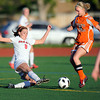 """Fairview High School's Meghan Higgins goes for a slide tackle on Grand Junction's Courtney Brady during a soccer game against Grand Junction High School on Wednesday, May 9, at Fairview in Boulder. For more photos of the game go to  <a href=""""http://www.dailycamera.com"""">http://www.dailycamera.com</a><br /> Jeremy Papasso/ Boulder Daily Camera"""