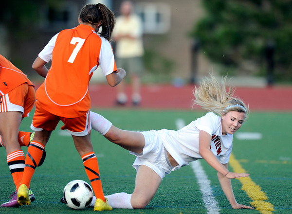 """Fairview High School's Reci Smith is knocked down by Grand Junction's Taylor Wood after going for a steal during a soccer game against Grand Junction High School on Wednesday, May 9, at Fairview in Boulder. For more photos of the game go to  <a href=""""http://www.dailycamera.com"""">http://www.dailycamera.com</a><br /> Jeremy Papasso/ Boulder Daily Camera"""