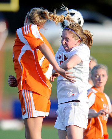"""Fairview High School's Zoe Verhoeven heads the ball over Grand Junction's Leah Swander during a soccer game against Grand Junction High School on Wednesday, May 9, at Fairview in Boulder. For more photos of the game go to  <a href=""""http://www.dailycamera.com"""">http://www.dailycamera.com</a><br /> Jeremy Papasso/ Boulder Daily Camera"""