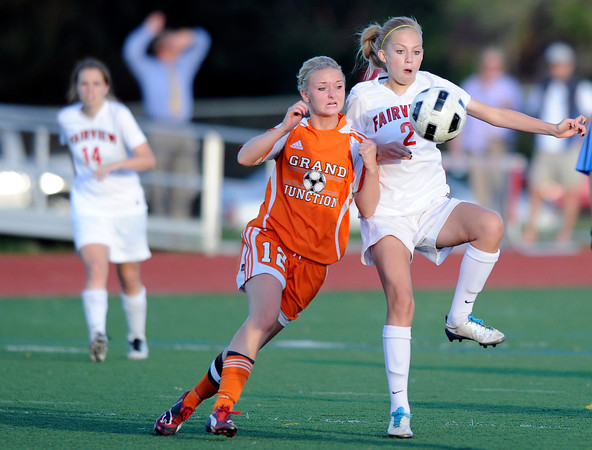 "Fairview High School's Gaelyn Crowder knees the ball while trying to keep it away from Grand Junction's Courtney Brady during a soccer game against Grand Junction High School on Wednesday, May 9, at Fairview in Boulder. For more photos of the game go to  <a href=""http://www.dailycamera.com"">http://www.dailycamera.com</a><br /> Jeremy Papasso/ Boulder Daily Camera"