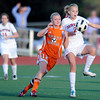 """Fairview High School's Gaelyn Crowder knees the ball while trying to keep it away from Grand Junction's Courtney Brady during a soccer game against Grand Junction High School on Wednesday, May 9, at Fairview in Boulder. For more photos of the game go to  <a href=""""http://www.dailycamera.com"""">http://www.dailycamera.com</a><br /> Jeremy Papasso/ Boulder Daily Camera"""