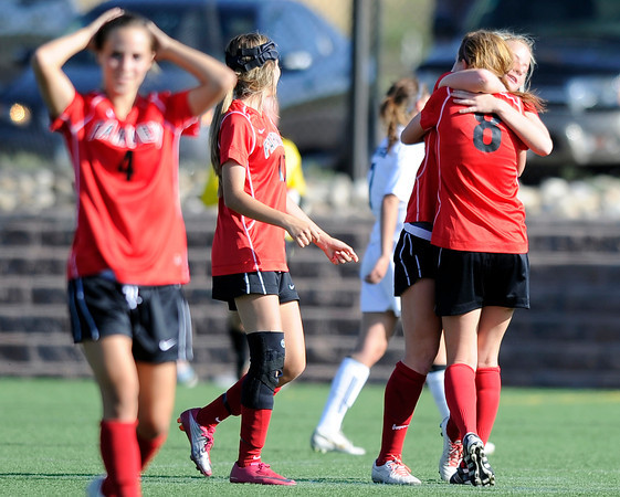 "Fairview High School's Olivia Fear, left, reacts while teammates Meghan Higgins, No. 8, hugs Berkley Gamble after defeating Heritage High School on Tuesday, May 15, at Shea Stadium in Highlands Ranch. For more photos of the game go to  <a href=""http://www.dailycamera.com"">http://www.dailycamera.com</a><br /> Jeremy Papasso/ Camera"