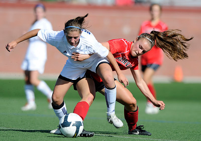 Fairview High School's Daphnee Morency, right, steals the ball from Jenna Geist during a game against Heritage High School on Tuesday, May 15, at Shea Stadium in Highlands Ranch. For more photos of the game go to www.dailycamera.com Jeremy Papasso/ Camera