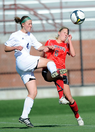"Fairview High School's Meghan Higgins, right, tries to head a ball in front of Heritage High School's Syd Slouka during a game against Heritage High School on Tuesday, May 15, at Shea Stadium in Highlands Ranch. For more photos of the game go to  <a href=""http://www.dailycamera.com"">http://www.dailycamera.com</a><br /> Jeremy Papasso/ Camera"