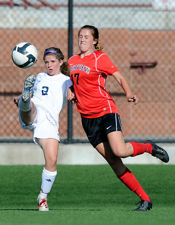 "Fairview High School's Kenzie Whitcomb, right, and Heritage High School's Alyssa Biever go for the ball during a game against Heritage High School on Tuesday, May 15, at Shea Stadium in Highlands Ranch. For more photos of the game go to  <a href=""http://www.dailycamera.com"">http://www.dailycamera.com</a><br /> Jeremy Papasso/ Camera"