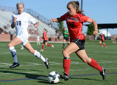 Fairview High School's Daphnee Morency dribbles the ball past Heritage High School's Chandler Zitzmann during a game against Heritage High School on Tuesday, May 15, at Shea Stadium in Highlands Ranch. For more photos of the game go to www.dailycamera.com Jeremy Papasso/ Camera
