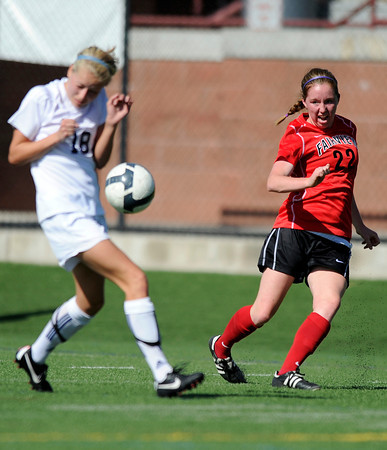 "Fairview High School's Lauren White, right, kicks the ball past Chandler Zitzmann during a game against Heritage High School on Tuesday, May 15, at Shea Stadium in Highlands Ranch. For more photos of the game go to  <a href=""http://www.dailycamera.com"">http://www.dailycamera.com</a><br /> Jeremy Papasso/ Camera"