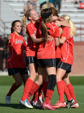 "Fairview High School's Gaelyn Crowder, front left, and Pyrenee Steiner , No. 15, jump in a group hug after defeating Heritage High School in a soccer game on Tuesday, May 15, at Shea Stadium in Highlands Ranch. For more photos of the game go to  <a href=""http://www.dailycamera.com"">http://www.dailycamera.com</a><br /> Jeremy Papasso/ Camera"