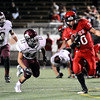 """Fairview High School's Ben Meyer breaks through the defense for a while rushing the ball on Friday, Sept. 23, during a football game against Horizon High School at Recht Field in Boulder. Fairview lost the game 14-10. For more photos of the game go to  <a href=""""http://www.dailycamera.com"""">http://www.dailycamera.com</a><br /> Jeremy Papasso/ Camera"""