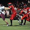 "Fairview High School's Andrew Cobb tries to tackle Andrew Patrick on Friday, Sept. 23, during a football game against Horizon High School at Recht Field in Boulder. Fairview lost the game 14-10. For more photos of the game go to  <a href=""http://www.dailycamera.com"">http://www.dailycamera.com</a><br /> Jeremy Papasso/ Camera"