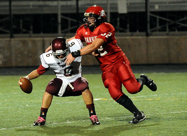 "Fairview High School's Victor Gallo sacks Horizon quarterback Brent Albrandt on Friday, Sept. 23, during a football game against Horizon High School at Recht Field in Boulder. Fairview lost the game 14-10. For more photos of the game go to  <a href=""http://www.dailycamera.com"">http://www.dailycamera.com</a><br /> Jeremy Papasso/ Camera"