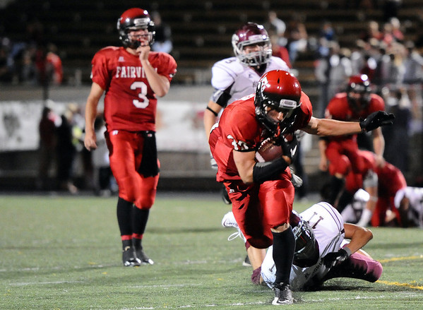 "Fairview High School's  Ben Meyer gets tackled by Steven Sumey after rushing the ball on Friday, Sept. 23, during a football game against Horizon High School at Recht Field in Boulder. Fairview lost the game 14-10. For more photos of the game go to  <a href=""http://www.dailycamera.com"">http://www.dailycamera.com</a><br /> Jeremy Papasso/ Camera"