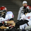 Fairview's quarterback Ben Schumacher hands off to Tucker Tharp during play against Legacy in Friday's game at 5 Star Stadium in Thornton.<br /> <br /> October 9, 2009<br /> Staff photo/David R. Jennings